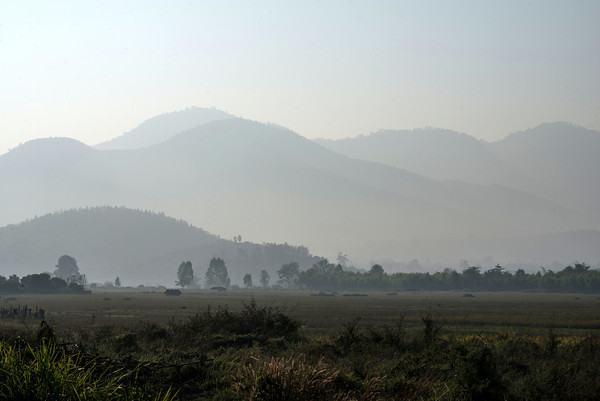 Glimpse of a nearby mountain range while riding a motorbike through Lamphun