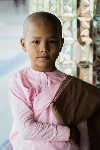 A young Burmese girl dressed in traditional female monk attire. Mandalay, Myanmar